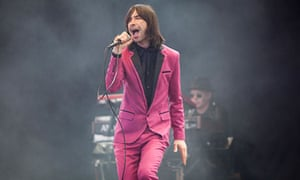 Bobby Gillespie of Primal Scream performing on the Pyramid stage at Glastonbury 2013