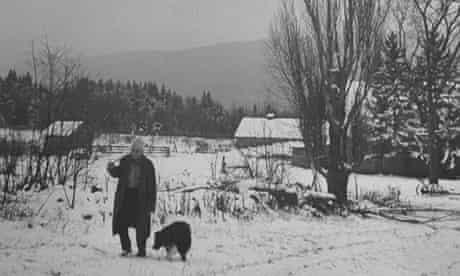 Poet Robert Frost in snowy woods in the US, around 1943
