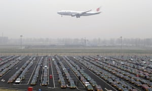 An Air China jetliner descends at Beijing airport