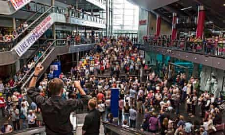 Critical mass … Simon Halsey conducts Crowd Out at Millenium Point, Birmingham.