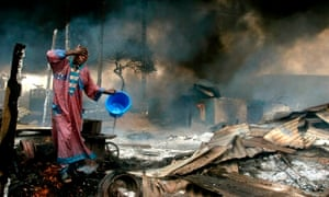 Akintunde Akinleye's shot of a man rinsing soot from his face