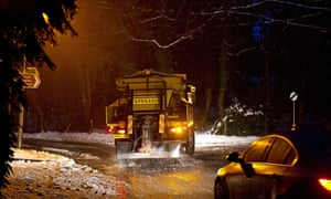 A gritter treats snow-covered the roads