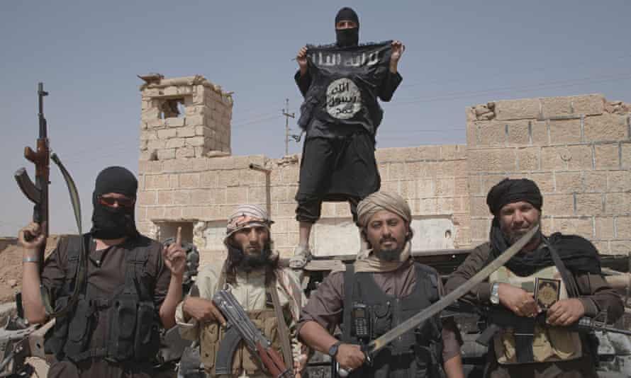 Islamic State Militants Patrol Syrian Border