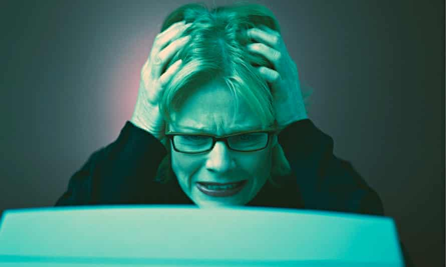 Frustrated Businesswoman Using a Computer