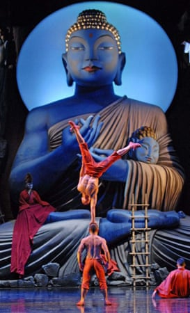 A scene from Monkey: Journey to the West featuring acrobatic balancing and a large Buddha Statue