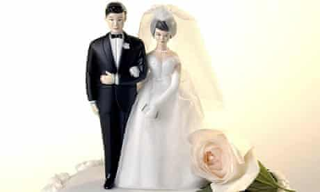 Bride and groom wedding figures on a cake suitable for a marriage