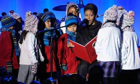 Michelle Obama reads 'The Night Before Christmas' to children at the White House.