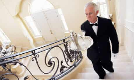 Butler Carrying Serving Tray Upstairs
