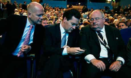 William Hague, George Osborne and Eric Pickles consult a Blackberry