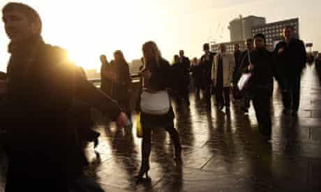 City workers walk across London Bridge