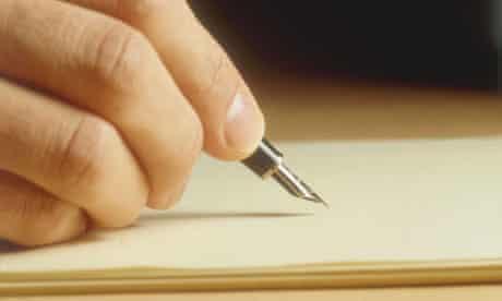 A man's hand writing