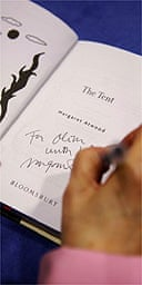 Margaret Atwood signing a book with  'The Long Pen'