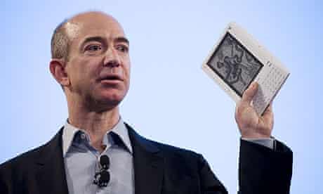 Amazon CEO Jeff Bezos brandishes new 'Kindle' ebook