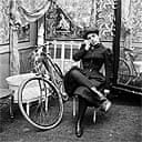 Lady dressed for bicycle ride 1900