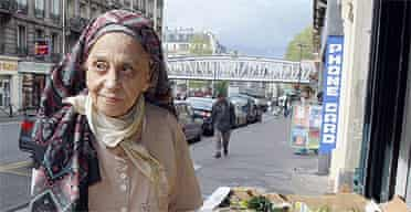 Lucie Ceccaldi, mother of French writer Michel Houellebecq poses at fruit stand in Paris on April 28, 2008.