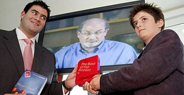 Salman Rushdie's children Zafar (l) and Milan (r) collect his Best of Booker award