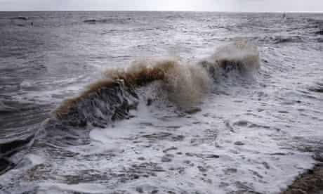 Waves crash onto a beach