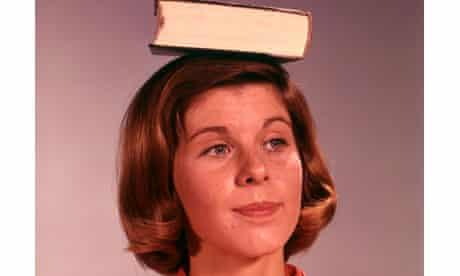 Woman balances book on her head