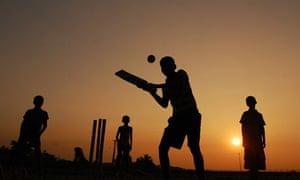 Playing cricket at dusk in Agartala, Tripura