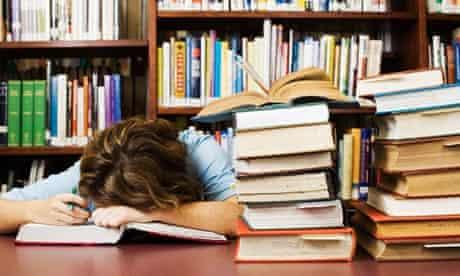 Woman asleep with books