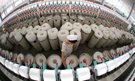 A textile worker in China's Jiangsu province