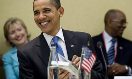 Barack Obama after being given a copy by Hugo Chávez of Open Veins of Latin America
