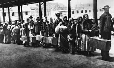 Immigrants queuing at Ellis Island, circa 1900.