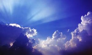 Sunbeams over clouds