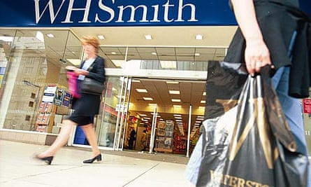 Shopper carries Waterstone's bag past a branch of WH Smith's