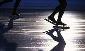 FEET OF ICE SKATERS, BLURRED