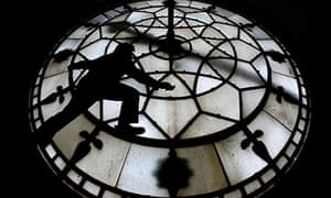 Horologist at work inside Manchester Town Hall's clockface
