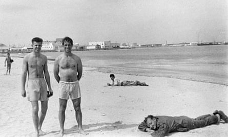 Peter Orlovsky, left, Jack Kerouac and William S. Burroughs (fully clothed) on a beach in Tangier