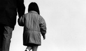 Father walking with daughter