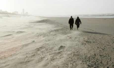 Walking on the beach during a sandstorm