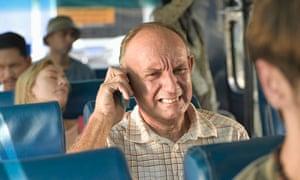 Man on bus using mobile