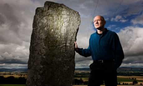 James Robertson by a standing stone at Newtyle, Scotland