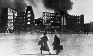 Two women look on as Stalingrad burns
