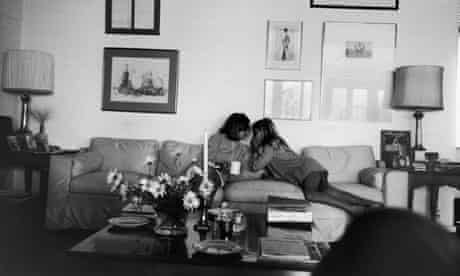 Joan Didion and her daughter on a couch at their Malibu home in 1976