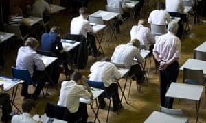 Schoolchildren sit an exam.