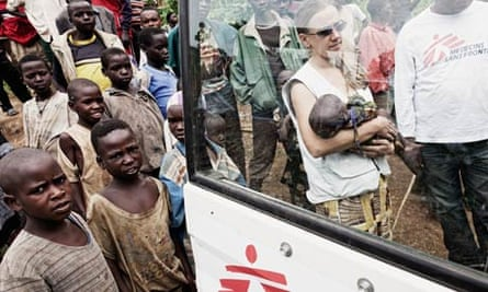 An MSF nurse carries a baby suffering from malnutrition in the Democratic Republic of the Congo