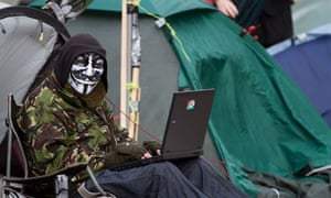 A protester sits outside at the Occupy London camp at St Pauls cathedral