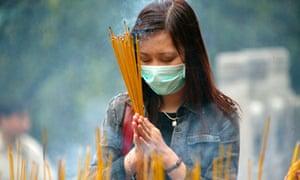 A Hong Kong Resident Wears A Mask