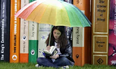 Teenage girl reading at the Hay Festival