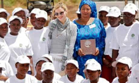 Madonna posing with schoolgirls