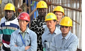 Seneglese and Chinese workers in dakar