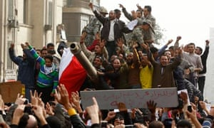Demonstrators on an army tank in Tahrir square during protests in Cairo