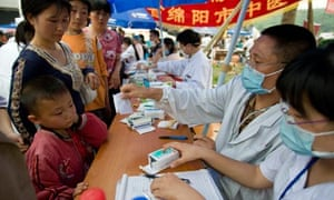 Medicines are dispensed in the refugee centre in Mianyang, Sichuan Province