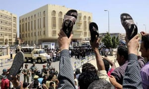 Demonstrators Interior Minister Habib el-Adli