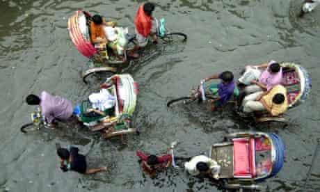 RICKSHAW IN WATER dhaka