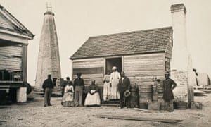 A group of slaves outside their quarters on a Georgia plantation.